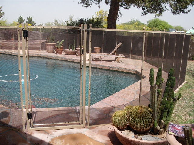 Mesh pool fence with self closing gate in color desert sand