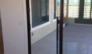 self-closing sliding glass door