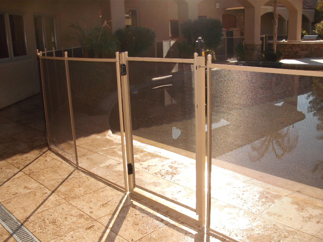 self closing gate for mesh pool fence in color desert sand matches decking