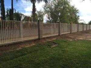 iron fence and block wall around a large acreage property