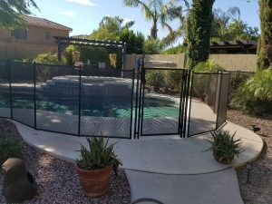 mesh pool fence installed on different surface types