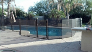 mesh pool fence with self closing and latching gate