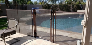 mesh pool fence with self closing and locking pool gate