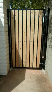 natural wood and iron side yard gate