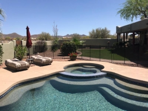 phoenix mesh pool fence mounted to stucco wall