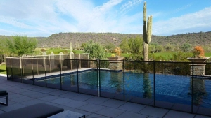 removable mesh fencing around infinity pool