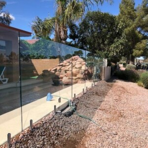 side view of glass fencing for pool