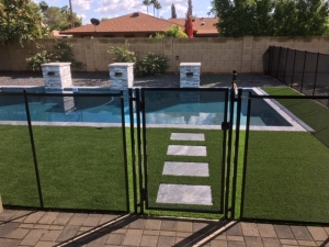 pool safety gate on black mesh fencing