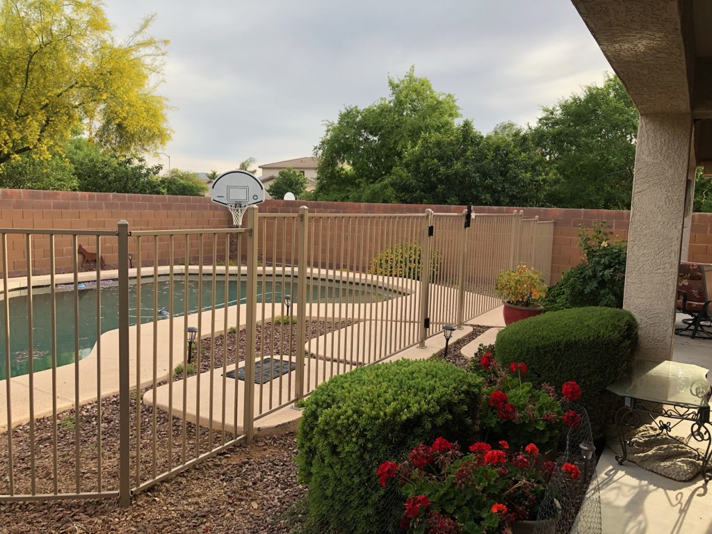 tan iron pool fence level changes